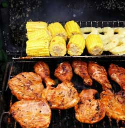 Meat and corn on a grill